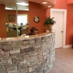 Custom Granite and Stacked Stone Receptionist Desk